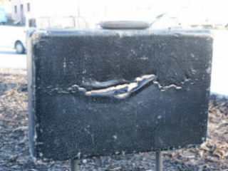One of the suitcases that was also vandalised along with the sculpture.