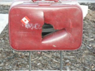 This suitcase was slashed by vandals.